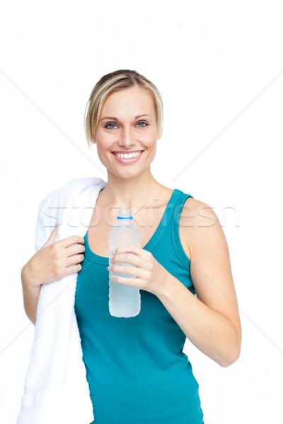 Photo stock: Souriant · jeune · femme · bouteille · eau · serviette · visage
