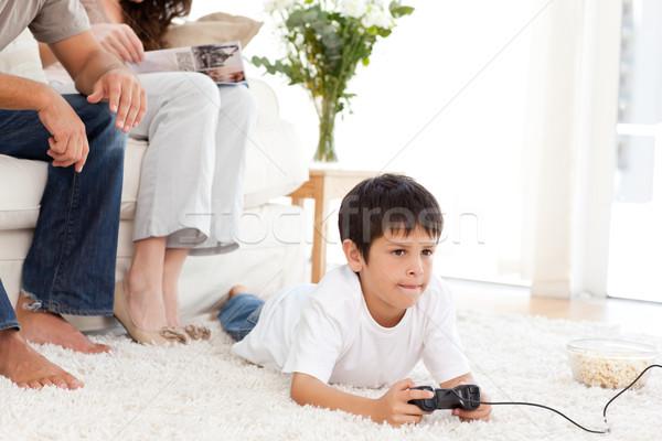 Sevimli erkek oynama video oyunu zemin ev Stok fotoğraf © wavebreak_media