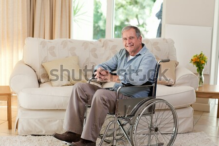 Stock photo: Senior man in his wheelchair at home