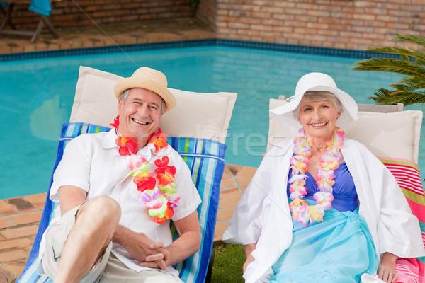 Couple de personnes âgées couché piscine homme été Photo stock © wavebreak_media