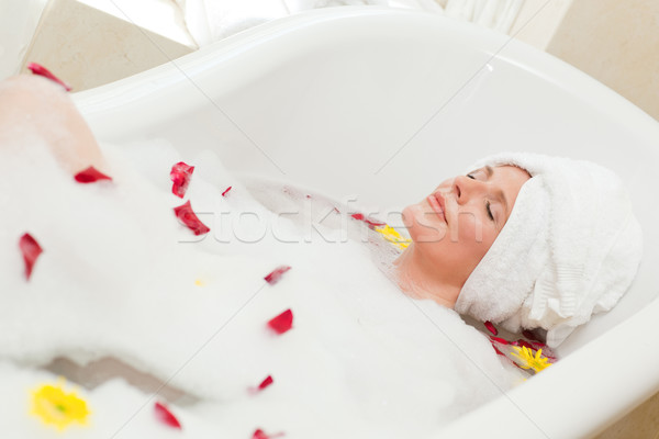 Pretty woman taking a relaxing bath with a towel on her head  Stock photo © wavebreak_media