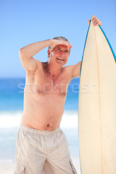 Homem maduro prancha de surfe praia feliz esportes verão Foto stock © wavebreak_media