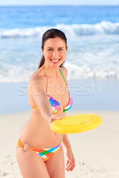 Beautiful woman playing frisbee Stock photo © wavebreak_media