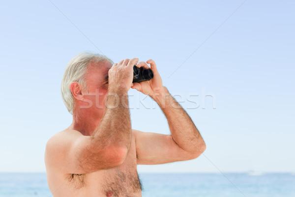 Senior man bird watching at the beach Stock photo © wavebreak_media