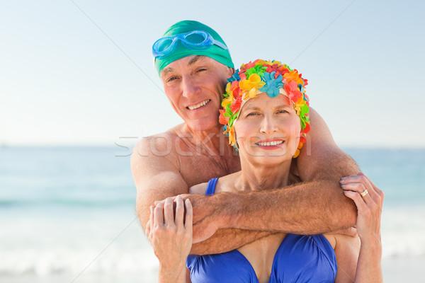 Uomo moglie spiaggia donna cielo Foto d'archivio © wavebreak_media