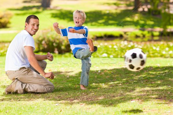 Padre jugando fútbol hijo mano cara Foto stock © wavebreak_media