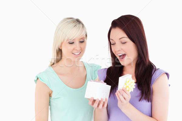 Blond woman gifting her friend in a studio Stock photo © wavebreak_media