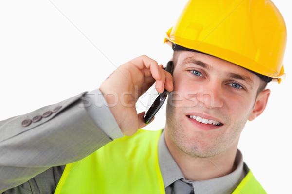Közelkép fiatal építész készít telefonbeszélgetés fehér Stock fotó © wavebreak_media