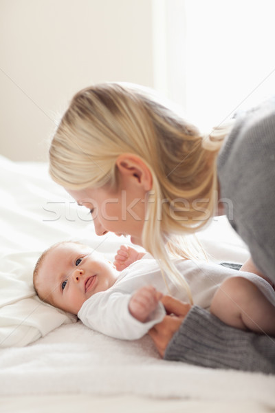 Affectionate young mom cuddling her newborn Stock photo © wavebreak_media
