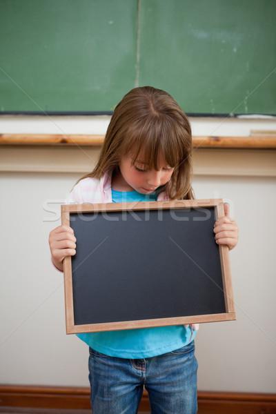 Portrait of a girl looking at a school slate in a classroom Stock photo © wavebreak_media