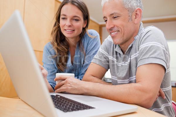 пару используя ноутбук кофе кухне дома любви Сток-фото © wavebreak_media