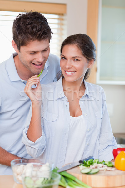 Portrait of a beautiful couple cooking in their kitchen Stock photo © wavebreak_media