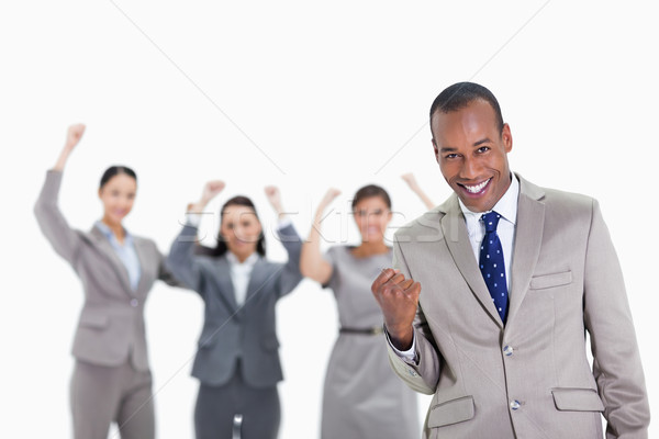 Close-up of a successful business team with man in foreground smiling and clenching his fist with th Stock photo © wavebreak_media