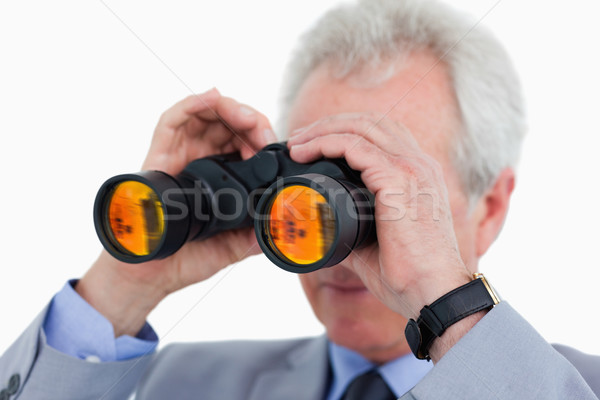 Close up of tradesman looking through binoculars against a white background Stock photo © wavebreak_media
