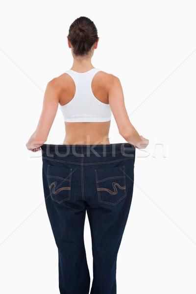 Vista posteriore donna perso peso bianco piedi Foto d'archivio © wavebreak_media