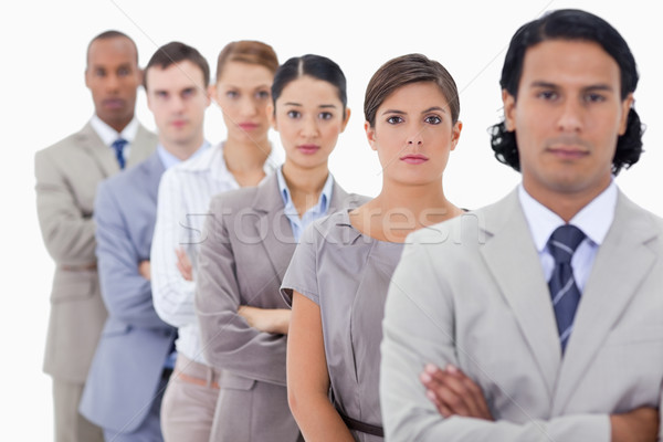 Big close-up of determined colleagues in a single line with focus on the first woman Stock photo © wavebreak_media