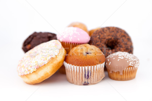 Many cakes laid out together against a white background Stock photo © wavebreak_media
