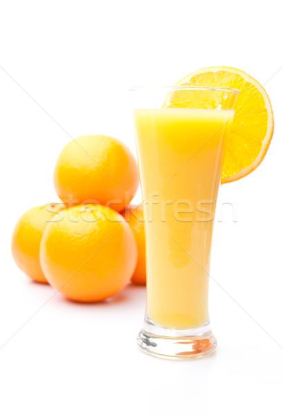 Stockfoto: Sinaasappelen · achter · glas · sinaasappelsap · witte