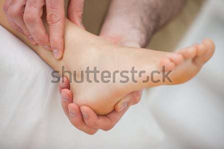 Barefoot being massaged by a doctor indoors Stock photo © wavebreak_media