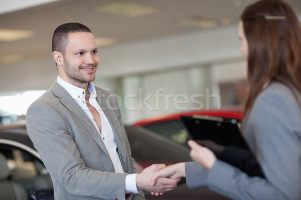 Businesswoman shaking hand of a client in a dealership Stock photo © wavebreak_media