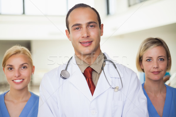 Doctor and a nurse on both sides in hospital hallway Stock photo © wavebreak_media