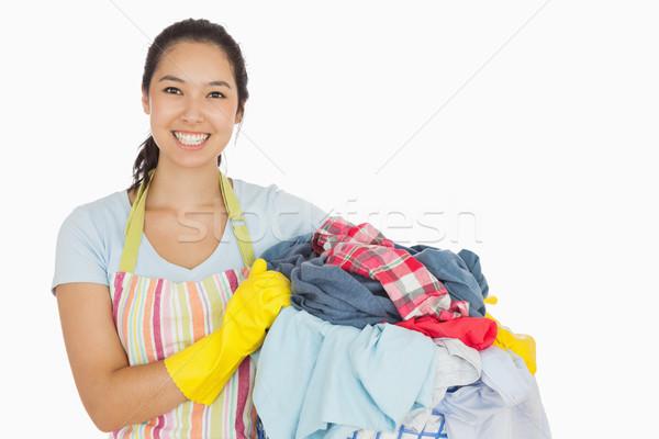 Risonho mulher cesto de roupa suja avental Foto stock © wavebreak_media