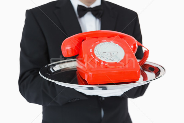 Waiter holding red dial phone on silver tray Stock photo © wavebreak_media
