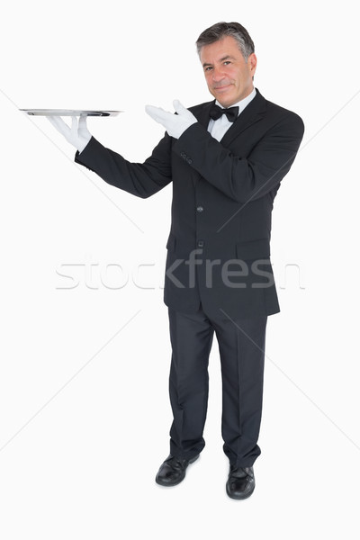Feliz camarero vacío plata bandeja Foto stock © wavebreak_media