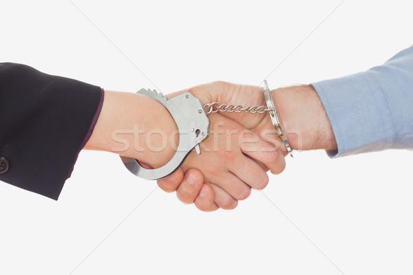 Business people in handcuffs shaking hands Stock photo © wavebreak_media