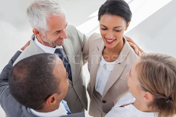 Mosolyog üzletemberek átkarol együtt munkahely nő Stock fotó © wavebreak_media