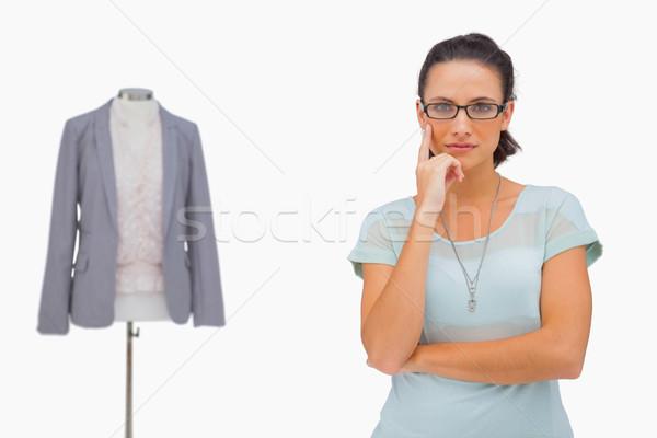 Thoughful fashion designer looking at camera Stock photo © wavebreak_media