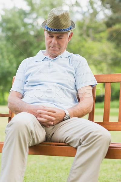Senior man sleeping on bench at park Stock photo © wavebreak_media