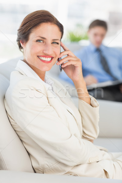 Cheerful businesswoman on the phone sitting on couch Stock photo © wavebreak_media