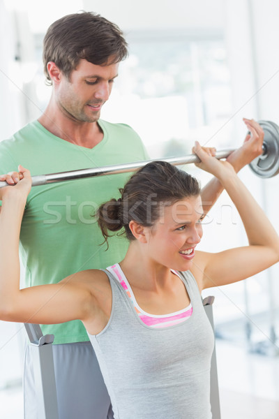 Treinador ajuda caber mulher elevador barbell Foto stock © wavebreak_media