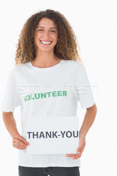 Sorridente voluntário obrigado cartaz branco Foto stock © wavebreak_media