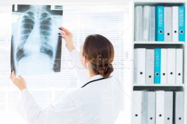Female doctor studying Xray Stock photo © wavebreak_media