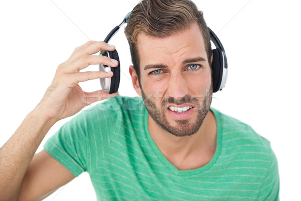 Portrait of a irritated young man with headphones Stock photo © wavebreak_media