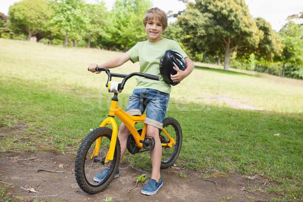 Smiling boy riding bicycle at park Stock photo © wavebreak_media
