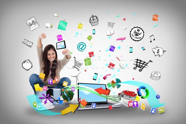 Kız dizüstü bilgisayar kullanıyorsanız uygulaması simgeler dijital bileşik Stok fotoğraf © wavebreak_media