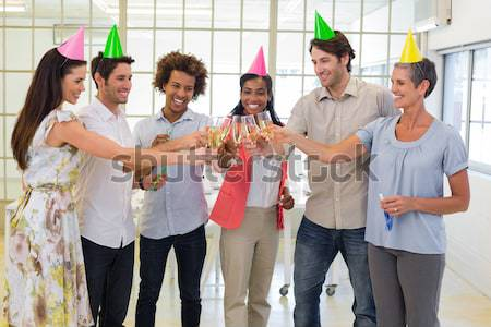 Coworkers laugh and celebrate accomplishment and enjoy party Stock photo © wavebreak_media