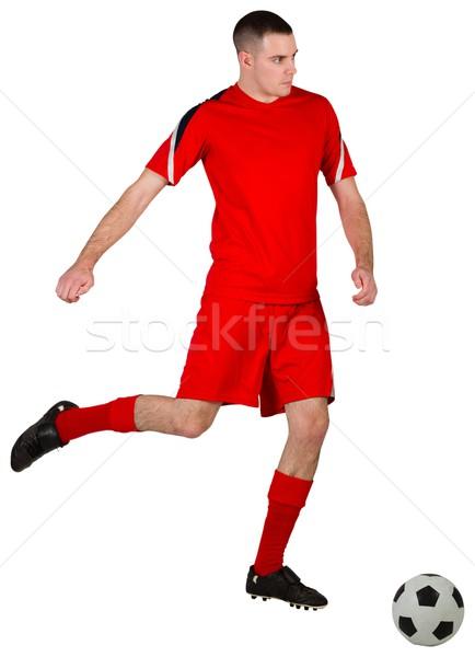 Fitt futballista játszik labda fehér futball Stock fotó © wavebreak_media