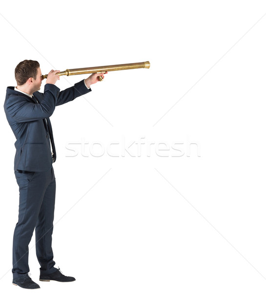 Businessman standing and looking through telescope Stock photo © wavebreak_media