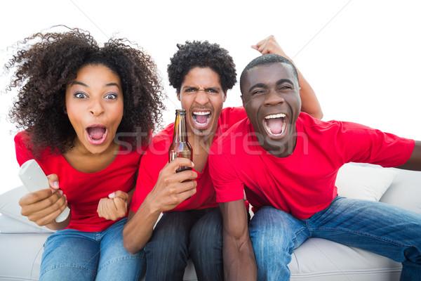 Foto stock: Futebol · fãs · vermelho · sofá · mulher