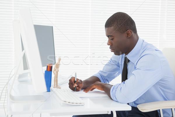 Jóképű üzletember dolgozik asztal iroda terv Stock fotó © wavebreak_media