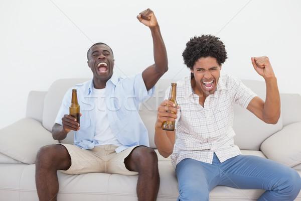 Voetbal fans juichen bier flessen Stockfoto © wavebreak_media