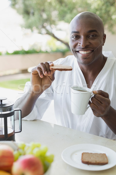 красивый мужчина халат завтрак за пределами дома Сток-фото © wavebreak_media