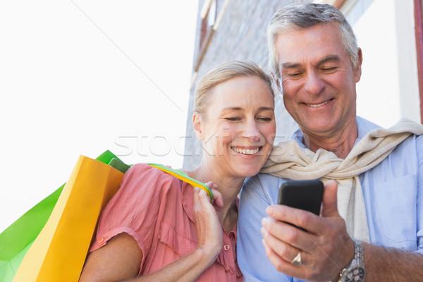 Gelukkig naar smartphone Stockfoto © wavebreak_media
