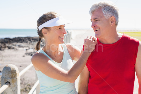 Fit mature couple warming up together on the pier Stock photo © wavebreak_media