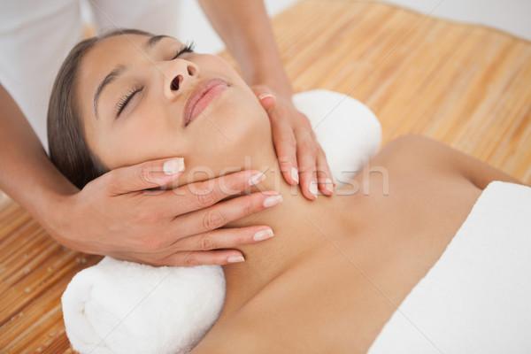 Beautiful brunette enjoying a head massage Stock photo © wavebreak_media