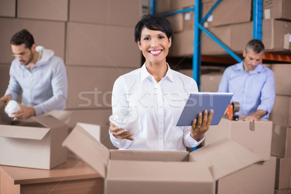 Armazém trabalhadores para cima caixas grande Foto stock © wavebreak_media